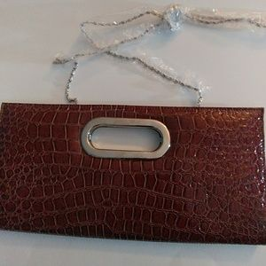 Brown faux alligator clutch bag.